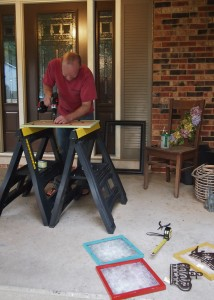 Brad drilling holes for colorful art frames;  www.makeoversandmotherhood.com