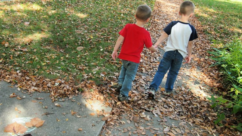 Holding hands to go on Number Nature Scavenger Hunt
