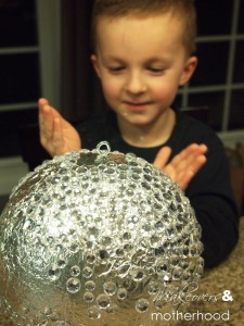 New Year's ball -- Connor & his reflection; www.makeoversandmotherhood.com