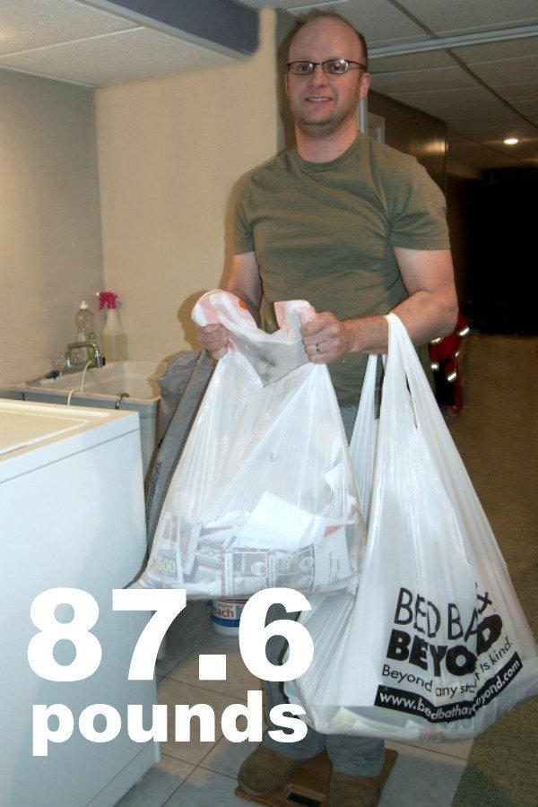 Brad holding bags of paper on the scale