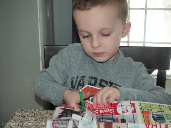 Kindergarten Cutting Activity -- Connor cutting; www.makeoversandmotherhood.com