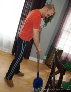 Brad sweeping up;  www.makeoversandmotherhood.com