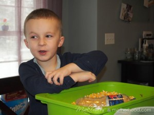 Connor with corn up his sleeve;  www.makeoversandmotherhood.com