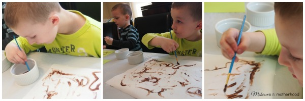 Connor painting with chocolate; www.makeoversandmotherhood.com