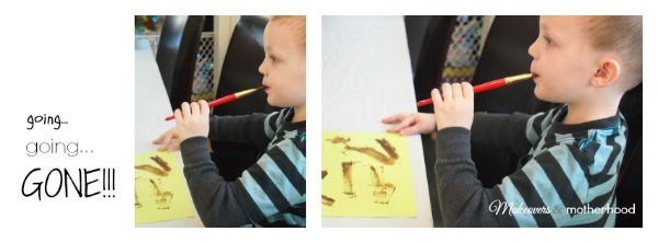 Dylan eating chocolate paintbrush; www.makeoversandmotherhood.com