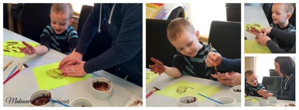 Painting Dylan's hands with chocolate; www.makeoversandmotherhood.com