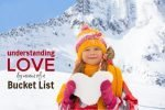 Girl holding snow heart